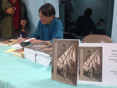 Ruthanne signing books at the Chinese Historical Society of New England